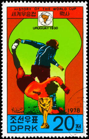 NORTH KOREA - CIRCA 1978: A Stamp printed in NORTH KOREA shows the Soccer players and championship emblem, Uruguay 1930, History of the World Cup, circa 1978 photo