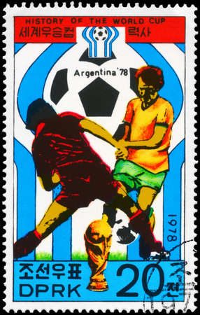 NORTH KOREA - CIRCA 1978: A Stamp printed in NORTH KOREA shows the Soccer players and championship emblem, Argentina 78, History of the World Cup, circa 1978