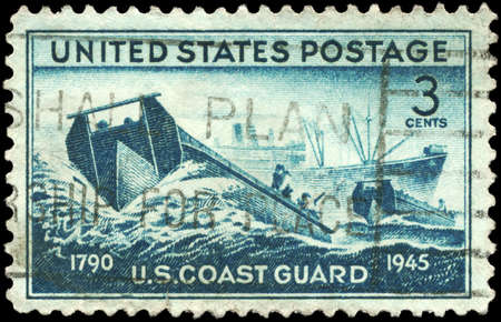 coast guard: USA - CIRCA 1945: A Stamp printed in USA shows the Coast Guard landing Craft and supply Ship, achievements of the US Coast Guard in WWII, circa 1945 Stock Photo