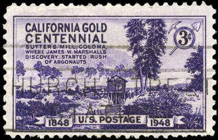 USA - CIRCA 1948: A Stamp printed in USA shows Sutters Mill, Coloma, Discovery of gold in California, centenary, circa 1948 photo