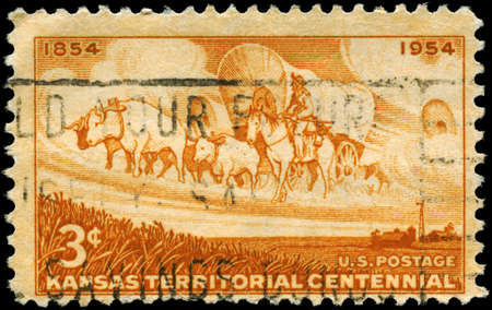 horse traction: USA - CIRCA 1954: A Stamp printed in USA shows the Wheat Field and Pioneer Wagon Train, Establishment of the Kansas Territory, century, circa 1954 Stock Photo