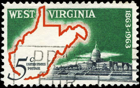 USA - CIRCA 1963: A Stamp printed in USA shows Map & State Capitol, West Virginia Statehood Centenary, circa 1963 photo