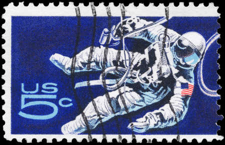 USA - CIRCA 1967: A Stamp printed in USA shows the Space-Walking Astronaut, Space Accomplishments Issue, circa 1967 photo