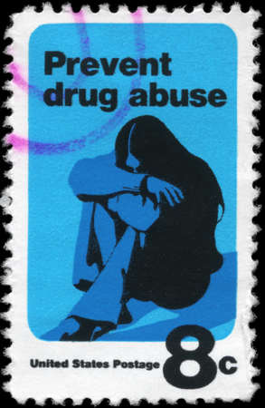 narcotism: USA - CIRCA 1971: A Stamp printed in USA shows a Young Woman Drug Addict, Prevent Drug Abuse Issue, circa 1971