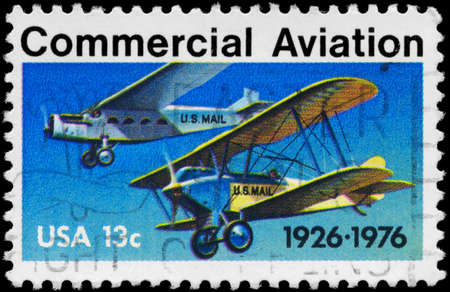 USA - CIRCA 1976: A Stamp printed in USA shows the Ford-Pullman Monoplane & Laird Swallow Biplane, Commercial Aviation Issue, 50th anniversary, circa 1976 photo