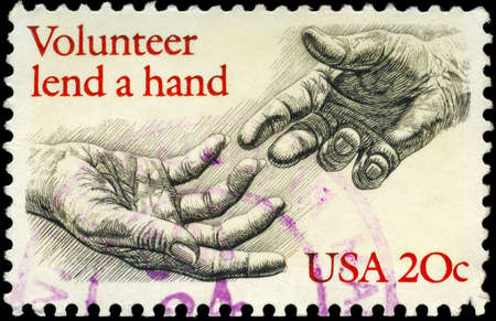 lend: USA - CIRCA 1983: A Stamp printed in USA shows the Human Hands, with the description Volunteer lend a hand, circa 1983 Stock Photo