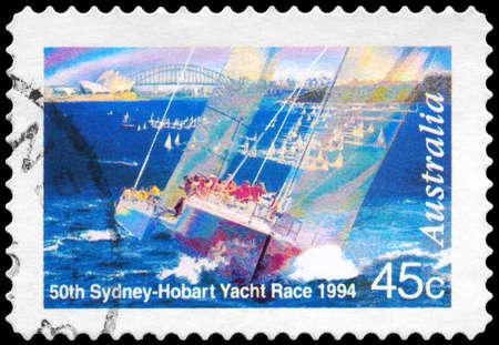 AUSTRALIA - CIRCA 1994: A Stamp printed in AUSTRALIA shows the Yachts bow-on, Sydney Opera House, Harbor Bridge, 50th Sydney-Hobart Yacht Race series, circa 1994 photo