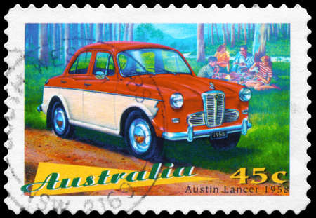 AUSTRALIA - CIRCA 1997: A Stamp printed in AUSTRALIA shows the Austin Lancer, 1958, Classic cars series, circa 1997 photo