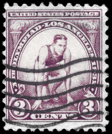 USA - CIRCA 1932: A Stamp printed in USA shows a Runner at Starting Mark, 10th Olympic Games Issue, circa 1932