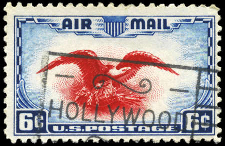 USA - CIRCA 1938: A Stamp printed in USA shows the Eagle holding Shield, Olive Branch and Arrows, circa 1938 photo