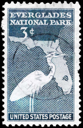 USA - CIRCA 1947: A Stamp printed in USA shows the Great White Heron and Map of Florida, Everglades National Park issue, circa 1947 photo