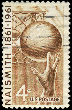invented: USA - CIRCA 1961: A Stamp printed in USA shows the Hand and Ball, honoring basketball and James Naismith (1861-1939), who invented the game in 1891, circa 1961 Stock Photo