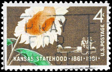 statehood: USA - CIRCA 1961: A Stamp printed in USA shows the Sunflower, Pioneer couple and Stockade, Kansas Statehood Centenary, circa 1961