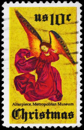 retablo: EE.UU. - CIRCA 1974: Un sello impreso en los EE.UU. muestra Angel, Retablo de Perussis, Metropolitan Museum of Art, Nueva York, alrededor de 1974