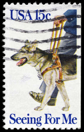 USA - CIRCA 1979: A Stamp printed in USA shows the German Shepherd leading Man, Seeing Eye Dogs issue, circa 1979
