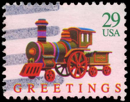 USA - CIRCA 1992: A Stamp printed in USA shows the Toy Locomotive, Christmas series, circa 1992 Stock Photo - 14986974