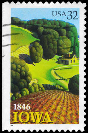 statehood: USA - CIRCA 1996: A Stamp printed in USA shows the Young Corn, by Grant Wood (1891-1942, Iowa Statehood, 150th anniversary, circa 1996 Stock Photo