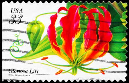 phytology: USA - CIRCA 1999: A Stamp printed in USA shows the Gloriosa Lily (Gloriosa superba), Tropical Flowers series, circa 1999