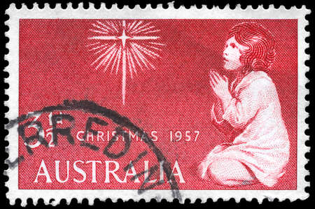 AUSTRALIA - CIRCA 1958: A Stamp printed in AUSTRALIA shows the Star of Bethlehem and Praying Child, Christmas issue, circa 1958 Stock Photo - 16376073