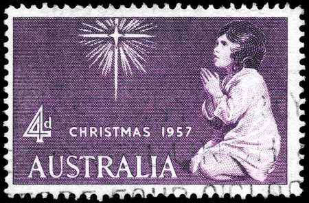AUSTRALIA - CIRCA 1958: A Stamp printed in AUSTRALIA shows the Star of Bethlehem and Praying Child, Christmas issue, circa 1958 Stock Photo - 16376080