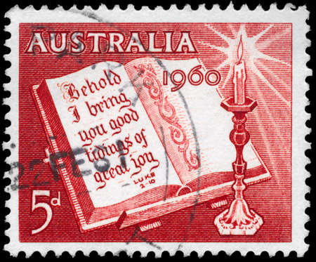 AUSTRALIA - CIRCA 1960: A Stamp printed in AUSTRALIA shows the Open Bible and Candle, circa 1960