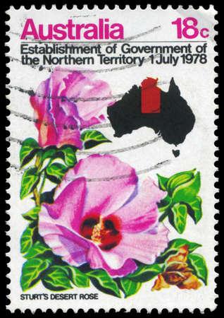 philately: AUSTRALIA - CIRCA 1978: A Stamp printed in AUSTRALIA shows the Sturts Desert Rose, Map of Australia, Establishment of Government of the Northern Territory, circa 1978 Editorial