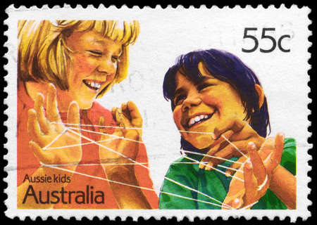 AUSTRALIA - CIRCA 1987: A Stamp printed in AUSTRALIA shows the Cat's cradle, Aussian Kids series, circa 1987 Stock Photo - 16376027