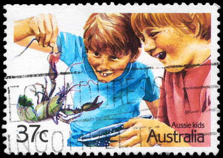 AUSTRALIA - CIRCA 1987: A Stamp printed in AUSTRALIA shows the Crayfishing, Aussian Kids series, circa 1987 Stock Photo - 16376076