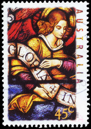 AUSTRALIA - CIRCA 1995: A Stamp printed in AUSTRALIA shows the Angel carrying Banner, Christmas series, circa 1995