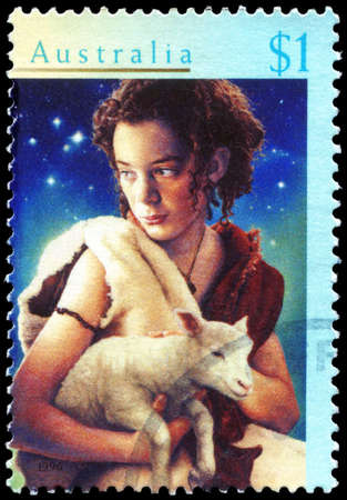 herder: AUSTRALIA - CIRCA 1996: A Stamp printed in AUSTRALIA shows the Shepherd Boy and Lamb, Christmas series, circa 1996 Editorial