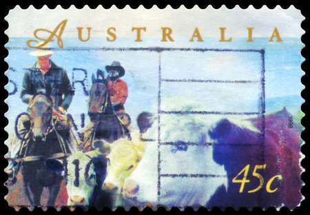 AUSTRALIA - CIRCA 1998: A Stamp printed in AUSTRALIA shows the Herding Cattle on Horseback, Farming series, circa 1998 Stock Photo - 16375879