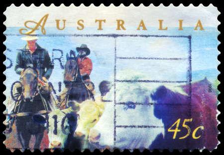 AUSTRALIA - CIRCA 1998: A Stamp printed in AUSTRALIA shows the Herding Cattle on Horseback, Farming series, circa 1998 Stock Photo - 16375879