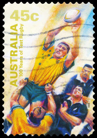 AUSTRALIA - CIRCA 1999: A Stamp printed in AUSTRALIA shows the Catching ball, 100 Years of Test Rugby, series, circa 1999 Stock Photo - 16375941
