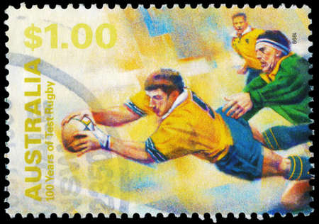 AUSTRALIA - CIRCA 1999: A Stamp printed in AUSTRALIA shows the Diving with ball, 100 Years of Test Rugby, series, circa 1999 Stock Photo - 16375917
