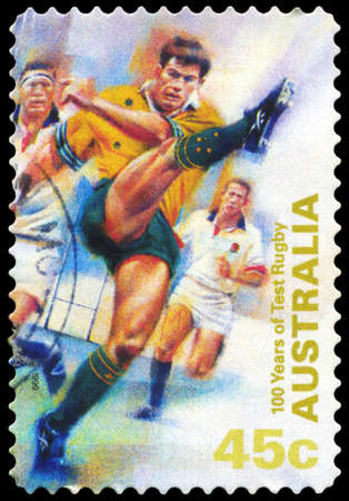 rugger: AUSTRALIA - CIRCA 1999: A Stamp printed in AUSTRALIA shows the Kicking ball, 100 Years of Test Rugby, series, circa 1999 Editorial
