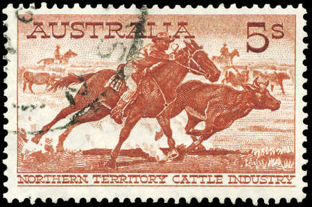 AUSTRALIA - CIRCA 1959: A Stamp printed in AUSTRALIA shows the Aboriginal Stockman Cutting Out a Steer, Northern Territory Cattle Industry issue, circa 1959 Stock Photo - 16652275