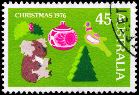 AUSTRALIA - CIRCA 1976: A Stamp printed in AUSTRALIA shows the Holly, Toy Koala, Christmas Tree and Decoration, Partridge, Christmas issue, circa 1976