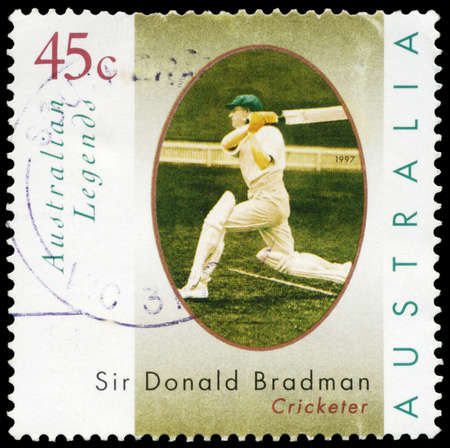 AUSTRALIA - CIRCA 1997: A Stamp printed in AUSTRALIA shows the portrait of a Sir Donald Bradman playing stroke, Australian Legends series, circa 1997