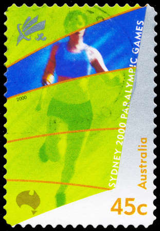 AUSTRALIA - CIRCA 2000: A Stamp printed in AUSTRALIA shows the Amputee running, 2000 Paralympics, Sydney, series, circa 2000 Stock Photo - 16652252
