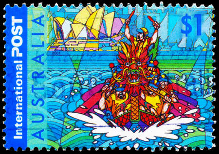 dragonboat: AUSTRALIA - CIRCA 2001: A Stamp printed in AUSTRALIA shows the Dragon Boat and Sydney Opera House, series, circa 2001 Editorial