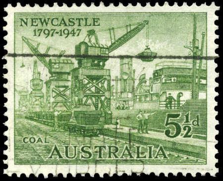 AUSTRALIA - CIRCA 1947: A Stamp printed in AUSTRALIA shows the Loading Coal, 150th anniversary of the discovery of the Hunter River estuary, circa 1947