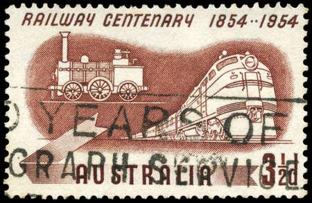 AUSTRALIA - CIRCA 1954: A Stamp printed in AUSTRALIA shows the Diesel and Early Steam Locomotives, Centenary of Australian railroads, circa 1954 photo