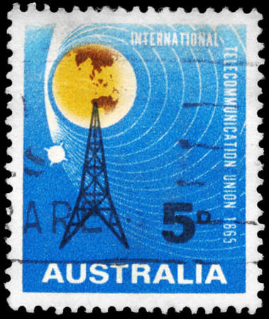AUSTRALIA - CIRCA 1965: A Stamp printed in AUSTRALIA shows the Radio Mast and Satellite Orbiting Earth, circa 1965 Stock Photo - 17422769