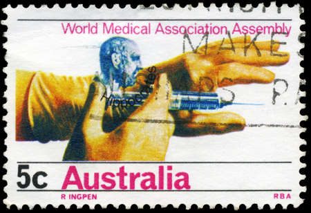 hippocrates: AUSTRALIA - CIRCA 1968: A Stamp printed in AUSTRALIA shows the Hippocrates and Hands holding Hypodermic, General Assembly of World Medical Associations, circa 1968