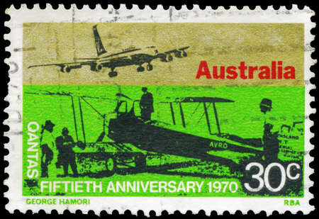 AUSTRALIA - CIRCA 1970: A Stamp printed in AUSTRALIA shows the Sunbeam Dyak powered Avro 504 on ground and Qantas Boeing 707 in the air, Australian overseas airlines, 50th anniversary, circa 1970 photo