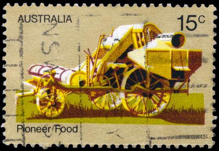 AUSTRALIA - CIRCA 1972: A Stamp printed in AUSTRALIA shows the 19th Century Combine Harvester, Australian Pioneer Life, series, circa 1972 Stock Photo - 17422792
