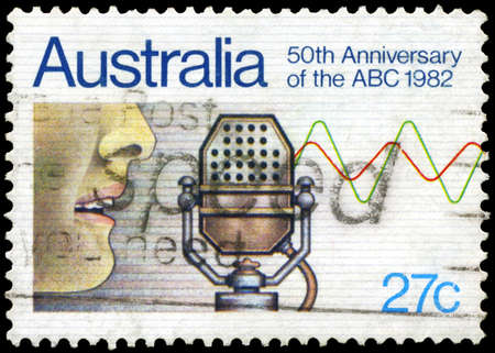 AUSTRALIA - CIRCA 1982: A Stamp printed in AUSTRALIA shows the Microphone, 50th annivesary of Australian Broadcasting Commission, circa 1982 Stock Photo - 17422779