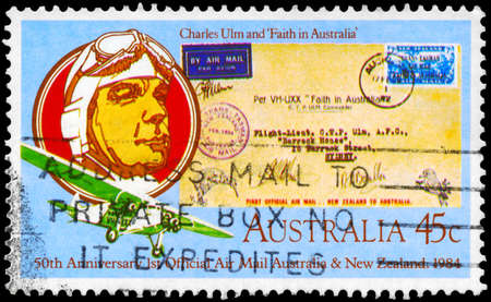 "AUSTRALIA - CIRCA 1984: A Stamp printed in AUSTRALIA shows the Pilot Charles Ulm (1898-1934), his Plane, ""Faith in Australia"", and Envelope, Australia - New Zealand Air Mail, circa 1984"