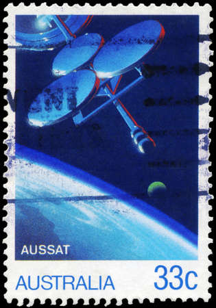 AUSTRALIA - CIRCA 1986: A Stamp printed in AUSTRALIA shows the AUSSAT Satellite, Moon and Earth's Surface, AUSSAT National Communications Satellite System, series, circa 1986 Stock Photo - 17422775