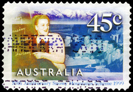 migrant: AUSTRALIA - CIRCA 1999: A Stamp printed in AUSTRALIA shows the English class for migrant workers at Cooma, Snowy Mountains Scheme, 50th anniversary, series, circa 1999